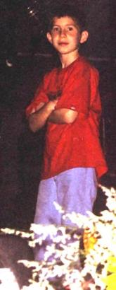 Adrian, Pauls first child with Edie Brickell.<br> This picture was taken on the summer tour 2002, where Adrian was with his dad for the first 5 concerts. He was sitting on stage always next to Steve Gadd's drum and playing percussion during 'Mrs. Ro
