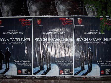 These three posters are bout 4.5 ft by 3.5 ft each and were posted on a billboard near the colosseum